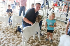 Luke Renyer, left, works with Hannah Lock, right, during Peewee Goat Showmanship at the Nemaha County Fair.