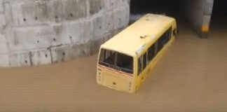 School bus with kids stuck in waterlogged underpass at kharva in Ajmer