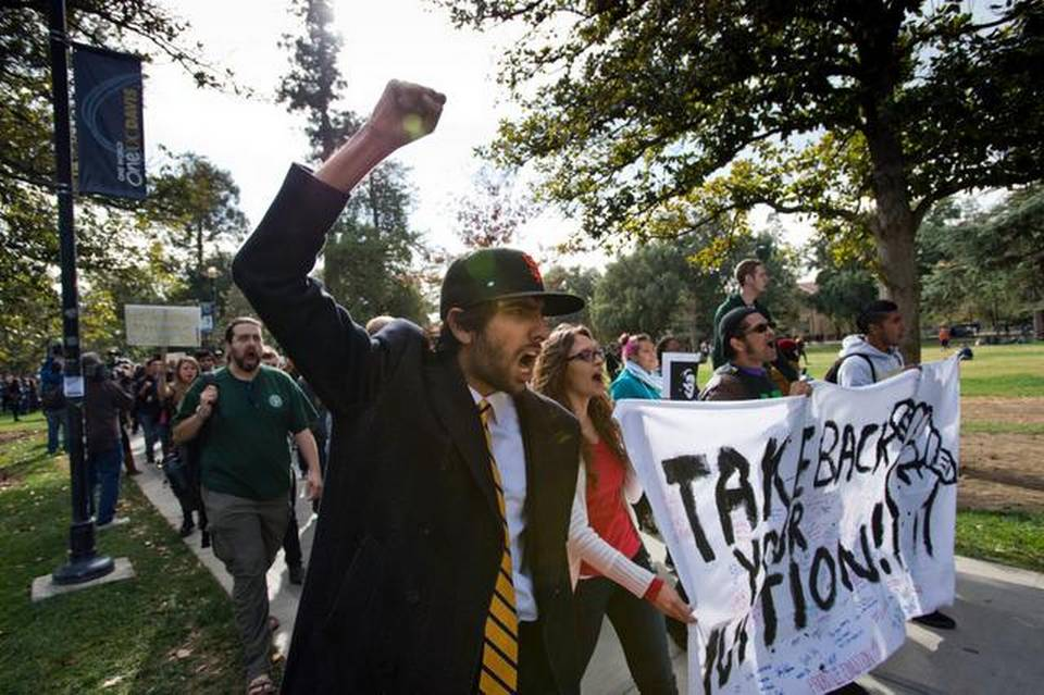 Fifth-year UC Davis student and former student association senator Kabir Kapur leads demonstrators as they march through campus to Mrak Hall on Tuesday protesting a proposal to increase tuition at the University of California system by up to 25 percent over five years.