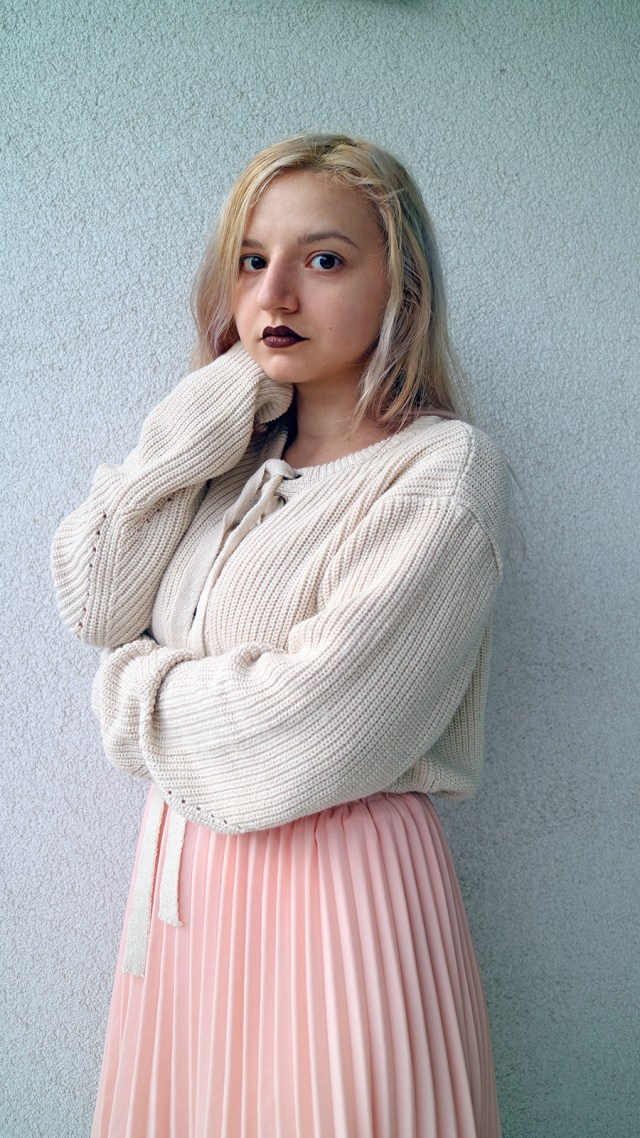 oversized laced up sweater with pleated skirt_