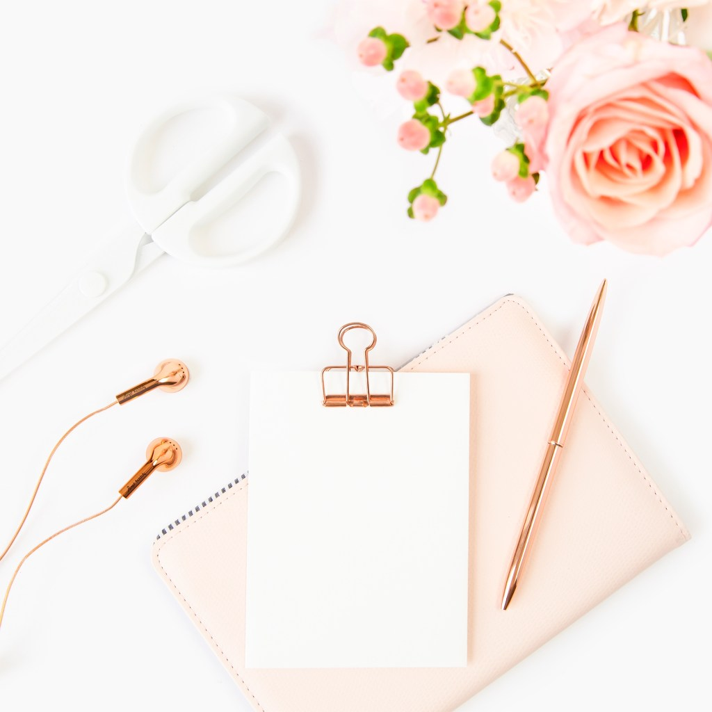 pale pink flowers and clipboard flat lay