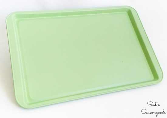 Spray painting metal of a cookie sheet as a magnet display board