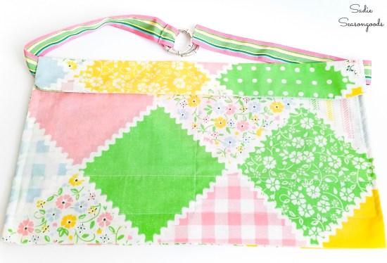 Repurposing a pillowcase and ribbon belt as a half apron