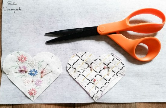 Pinning the embroidered linens to firm interfacing