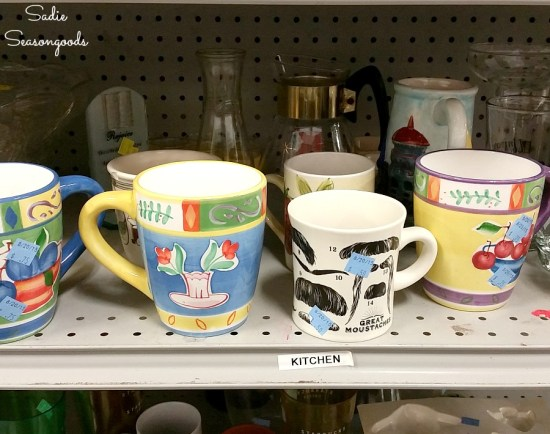 Coffee mugs at the thrift store to use in coffee gifts or gifts for tea lovers with wooden canisters