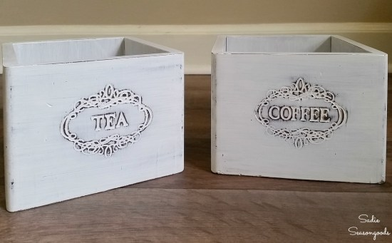 Tea and coffee canisters that have been painted to look more like a wooden gift box