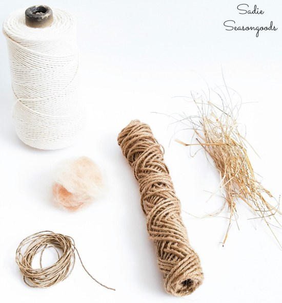 Nesting material for wild birds with untreated pet fur and cotton string and dried grass