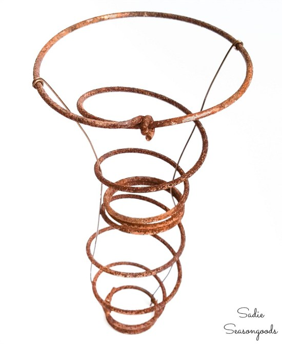 Rusty spring with jewelry wire on the sides to hold the nesting material