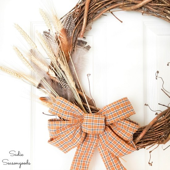 Harvest wreath with a bow made from plaid ribbon