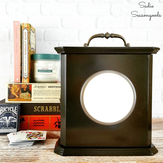Clock Box that was upcycled into a power outage kit and emergency lamp that is filled with supplies and looks like a vintage lantern