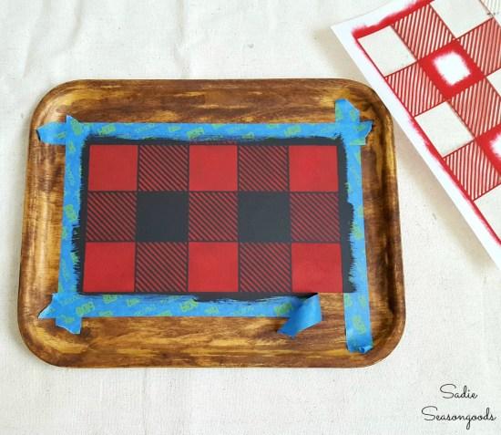 Using a Buffalo check stencil or Buffalo plaid stencil on a wooden tray to create the rustic cabin decor
