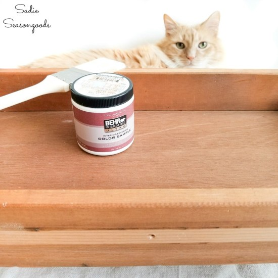 Painting the old drawers with samples of latex paint