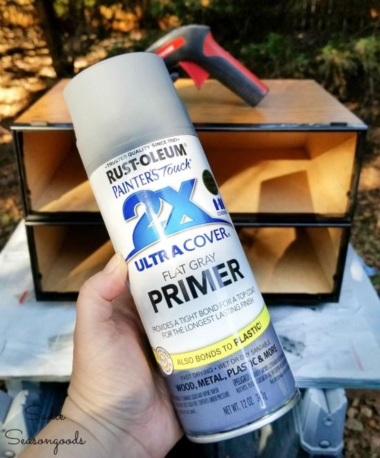 Spray primer before using metallic paint on VHS storage