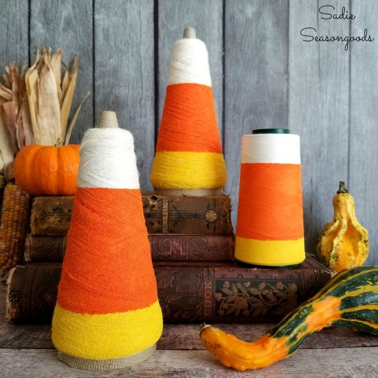 Candy corn decorations for Halloween decor by upcycling the thread cones or serger thread with a candy corn template by Sadie Seasongoods