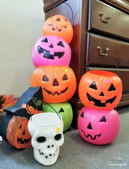 Plastic pumpkins at a thrift store