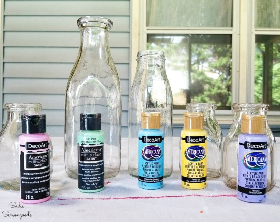 Painting the inside of the vintage glass milk bottles as Spring decor ideas