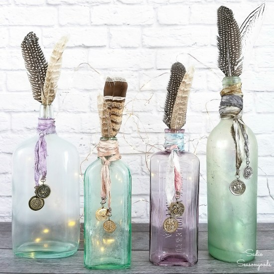 Old Bottles and coin charms as Boho decor ideas and bohemian vases