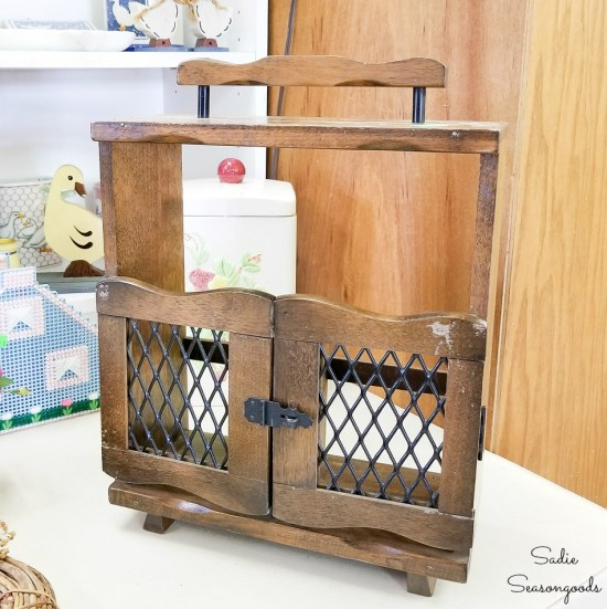Wooden caddy for liquor decanters at a thrift shop