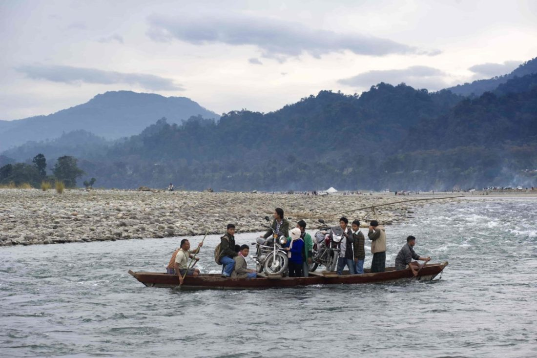 Passengers crossing the Noa Dihing river using the ferry boat service in Miao.
