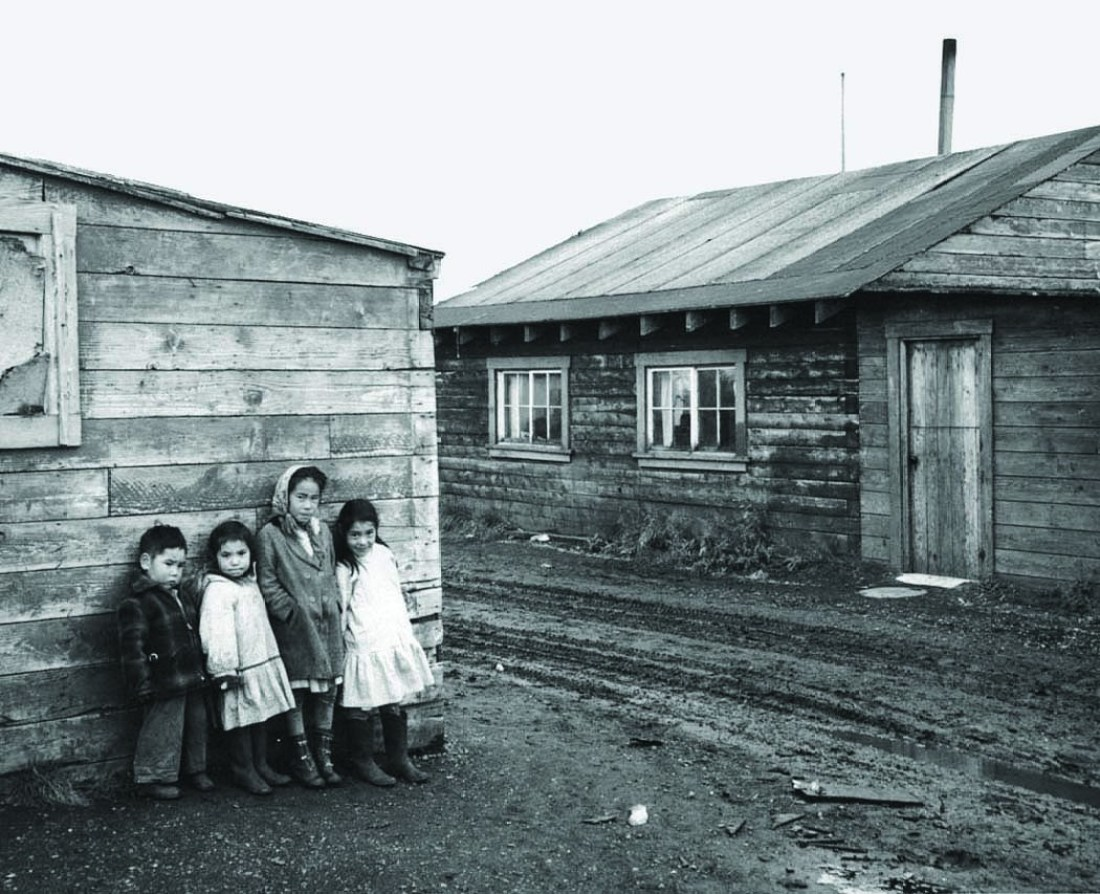 Children standing by Native Alaskan homes in Kotzebue. | Photo: Haddon, EP/USFWS
