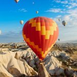 Warm clothes and sensible footwear are recommended during a hot-air balloon safari