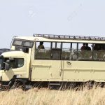 MASAI MARA, KENYA-OCTOBER 20: A Safari bus in the grassland of Masai Mara for game drive in Masai Mara National Reserve (National Park) on October 20, 2013 in Masai Mara, Kenya, Africa.