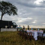 The breakfast that follows the hot-air balloon ride is set up typically under the shade of a single acacia tree