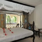 The Swahili atmosphere is enhanced by the Pili-Pili carved four-poster double beds in each of the rooms and Swahili easy chairs on the balconies