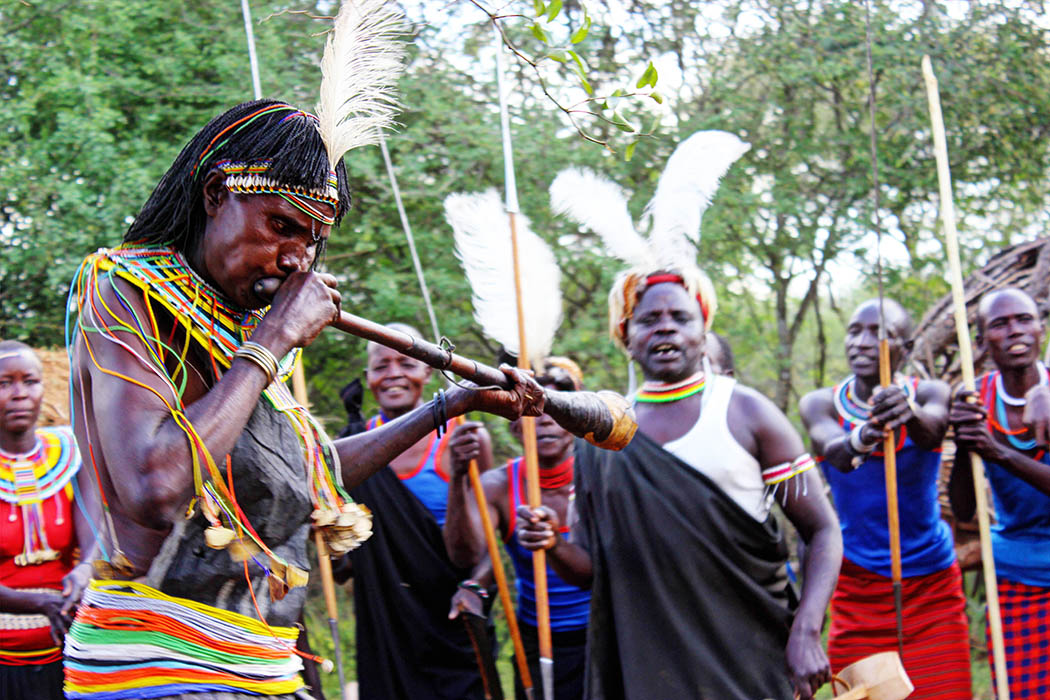 Sights & People from the North Rift_Pokot woman playing instrument