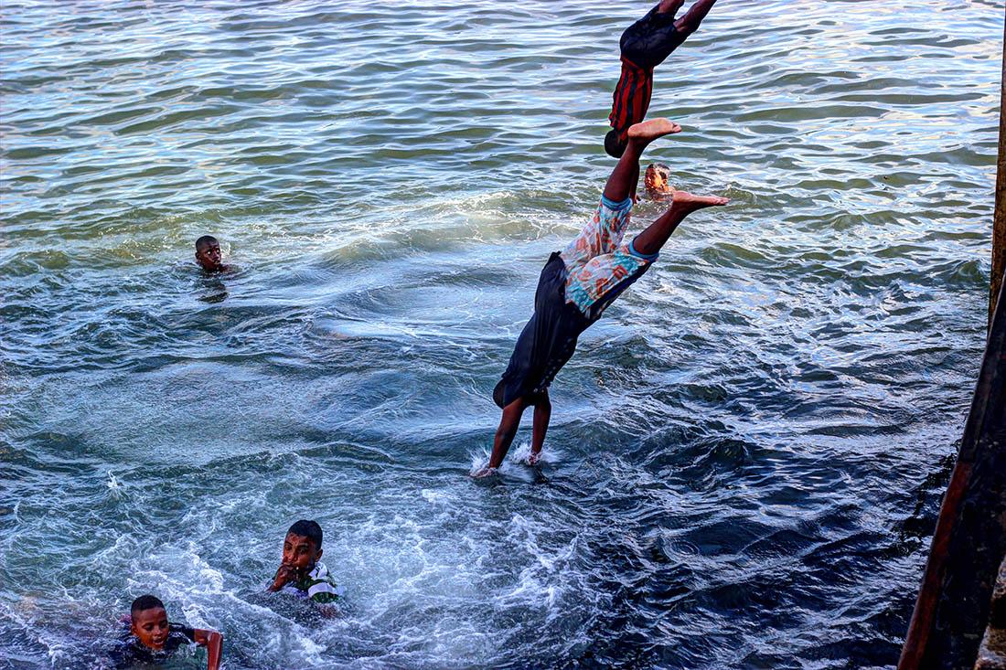 Lamu Town_Boy jumping from jetty.2