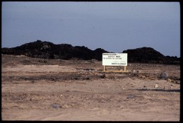 Last burning well in Kuwait sign