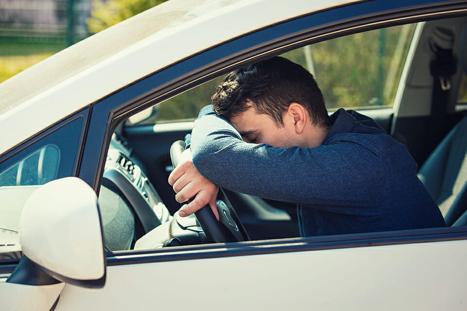 Importance of Sleep showing a sleeping driver