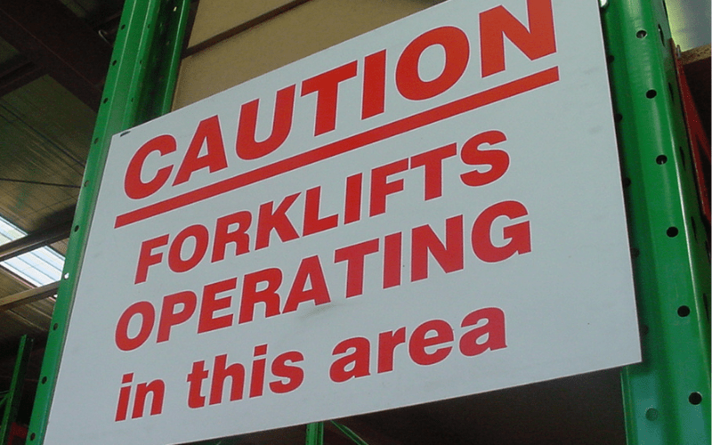Forklift operating in warehouse sign
