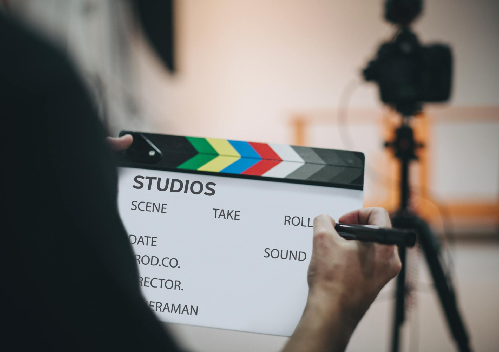 Person holding a clapperboard