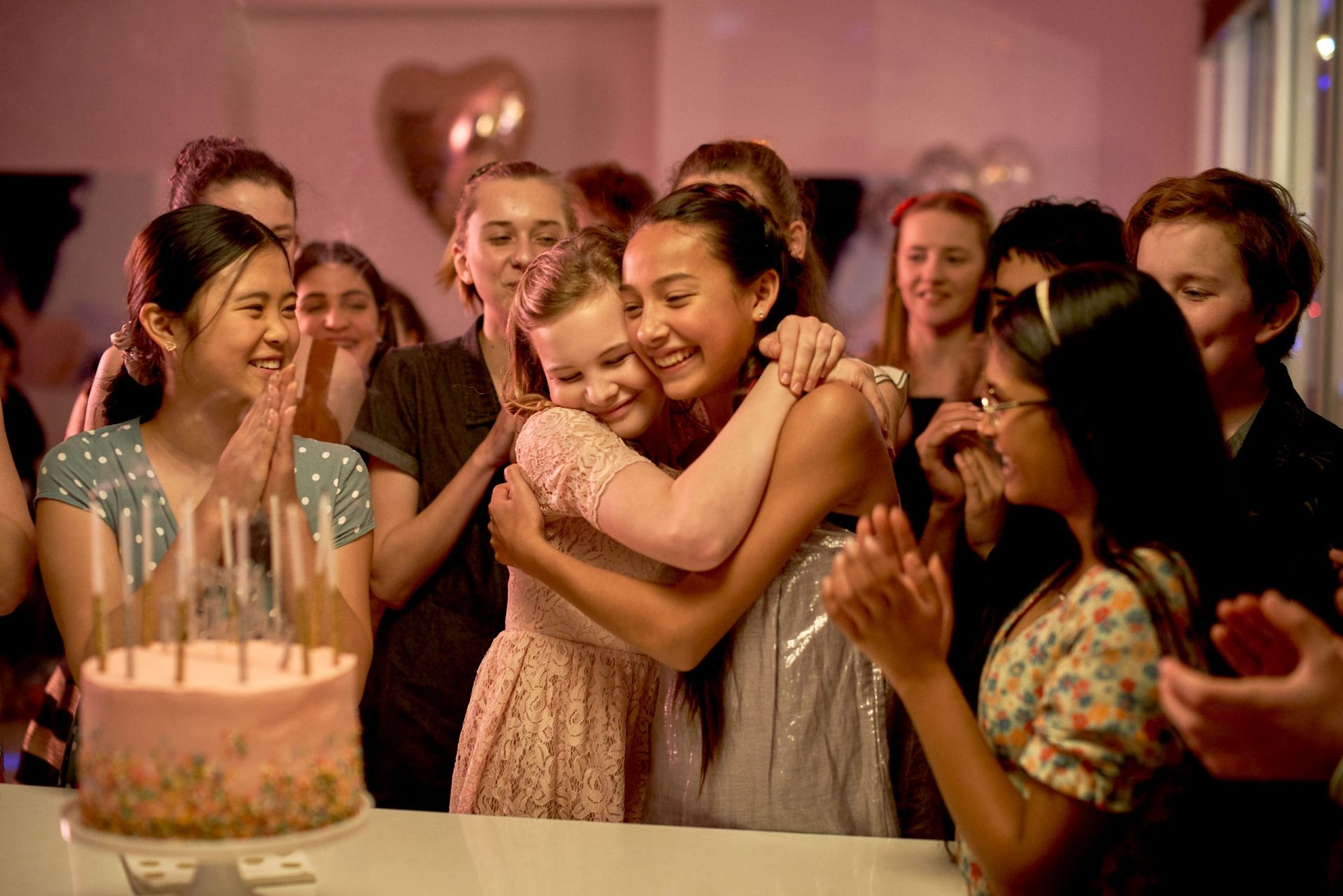First Day (2019): Evie Macdonald hugs Arwen Diamond, while Elena Liu and Nandini Rajagopal look on. Photo by ian Routledge, courtesy Epic Films