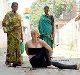 woman doing yoga on street