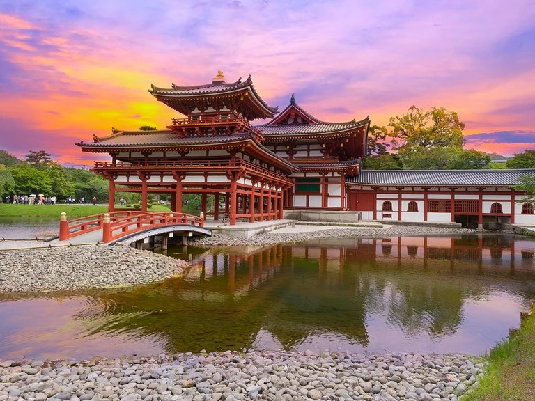Uji, Kyoto, Japan - famous Byodo-in Buddhist temple with peaple at sunset time