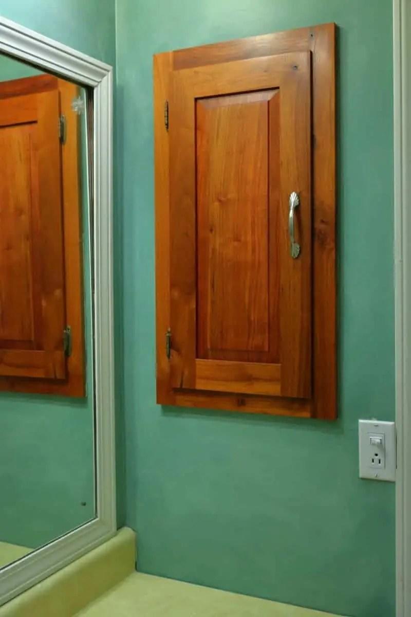 Wood medicine cabinet before bathroom remodel
