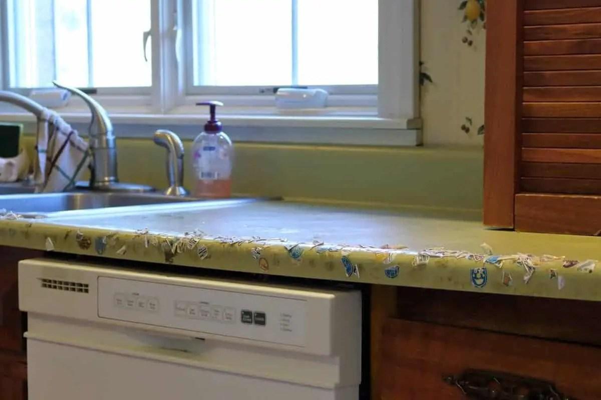 Kitchen makeover before - green counter, sink, white dishwasher