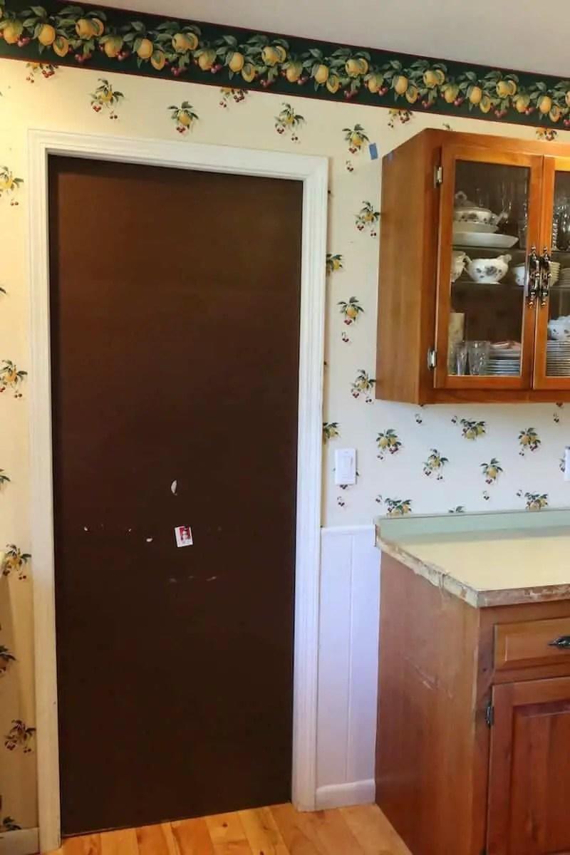 Dark brown door, green counters before the kitchen remodel