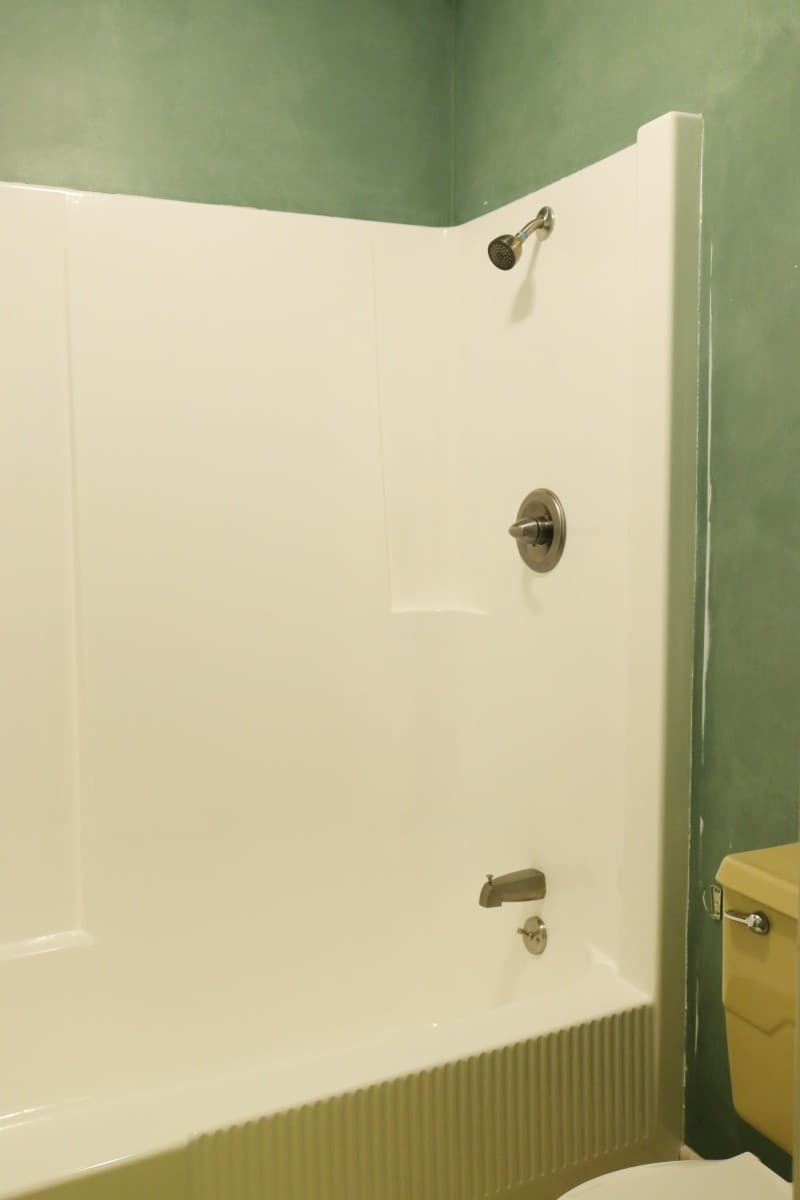 White fiberglass tub and shower after DIY refinishing