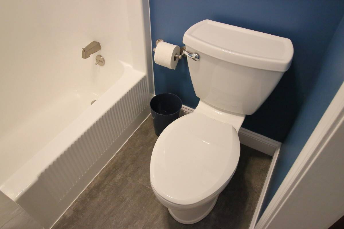 Remodeled bathroom with new low flush toilet