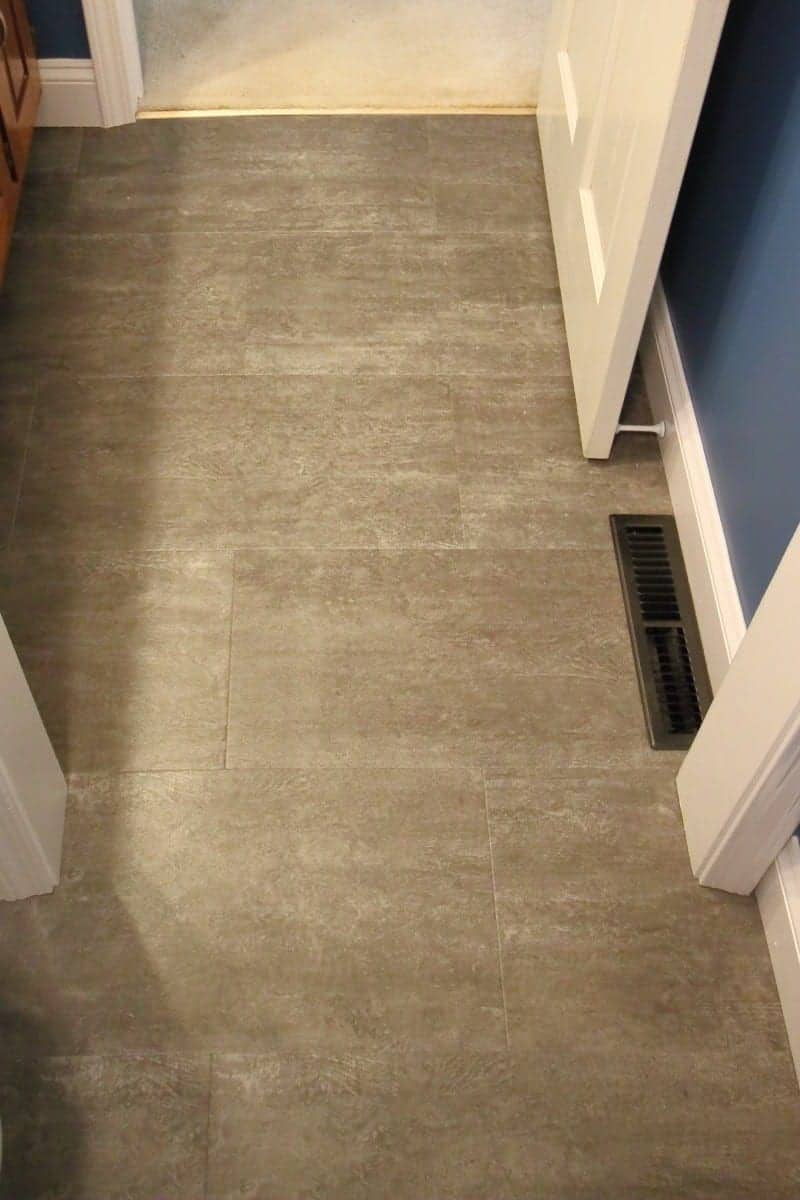 Photo of dark grey luxury vinyl tile flooring