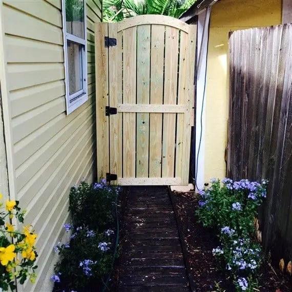 Arched top wooden garden gate