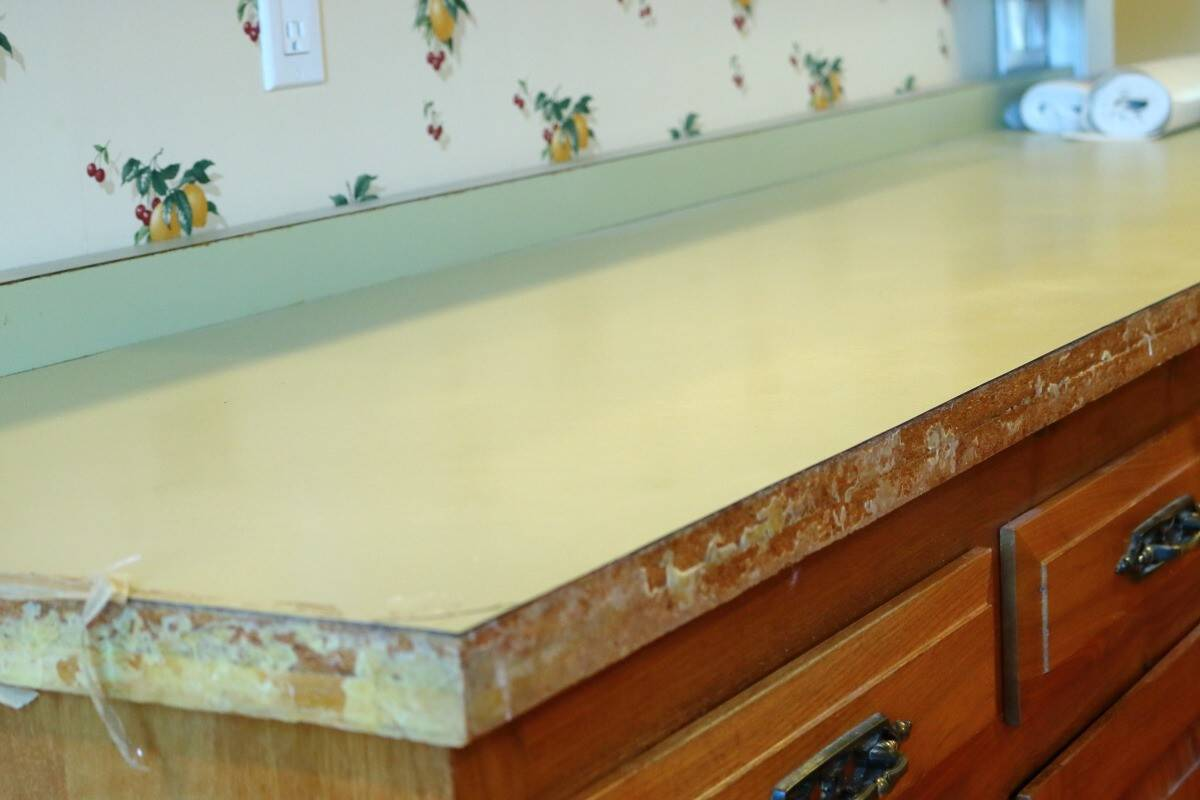 Before picture of kitchen remodel - avocado green plastic laminate countertop