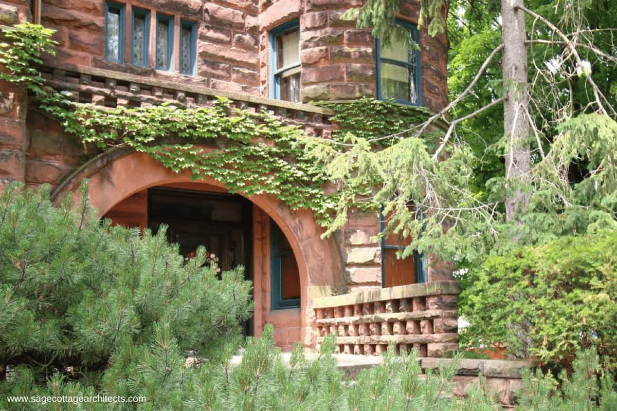 Like many Richardsonian Romanesque homes, the large arched entry porch is made of stone masonry.