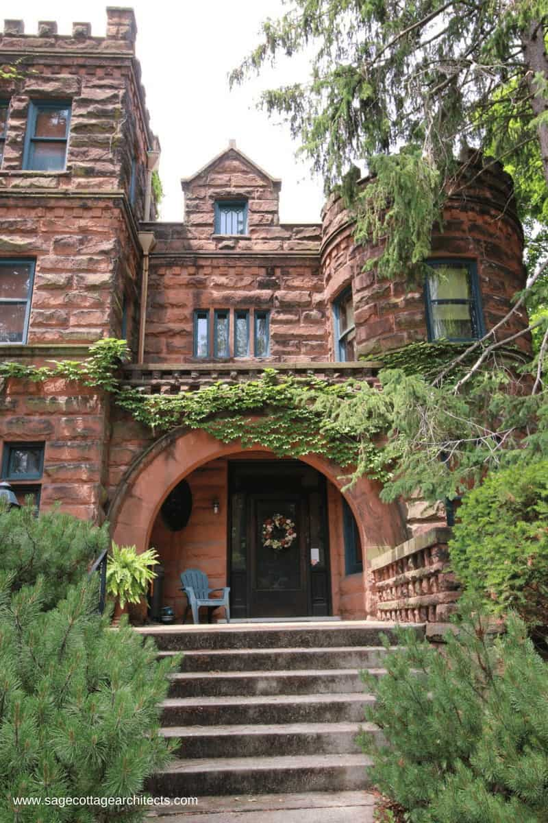 Like most Richardsonian Romanesque homes, this home has an arched entry porch