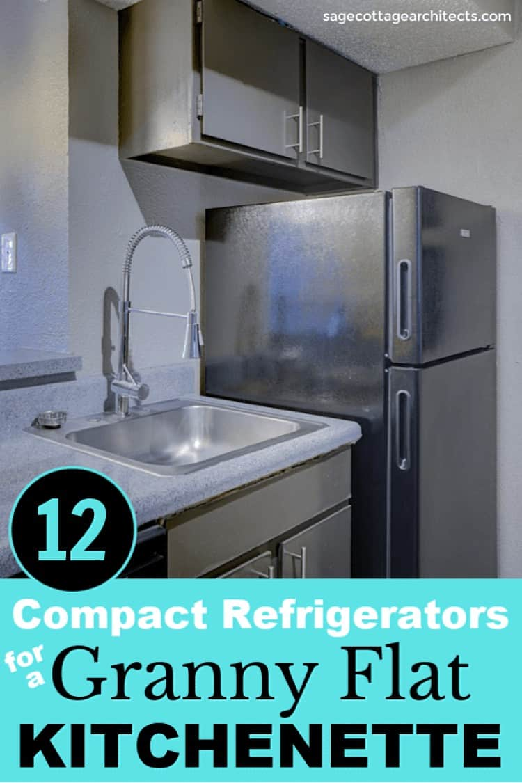 Stainless steel refrigerator and sink in a small dark grey kitchenette