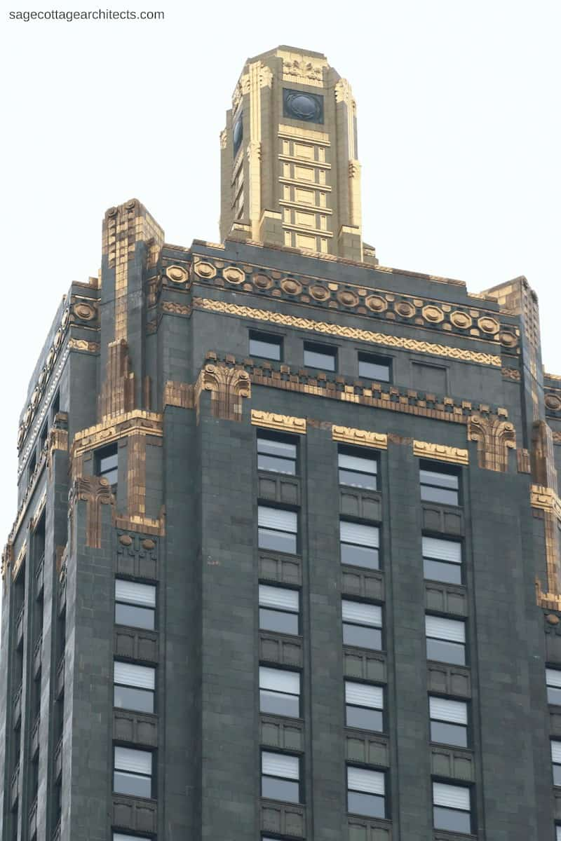 Top of the Carbide and Carbon Building dark green tower with bronze details and gold covered beacon.