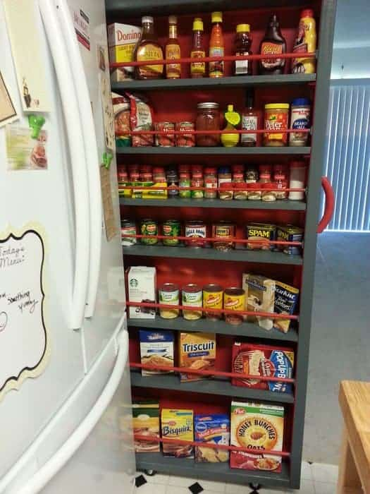 Rolling pantry cabinet that slides between the refrigerator and wall is another good storage idea.